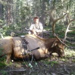 Hunter with Elk in Woods